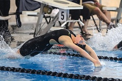 Photo Credit: HILLSBORO TRIBUNE PHOTO: AMANDA MILES - Century junior Sara Metzsch dives into the pool at the start of the girls 100-yard backstroke on Saturday at the Class 6A state swim meet. Metzsch tied for first place in 54.78 seconds, which broke the state meet record.