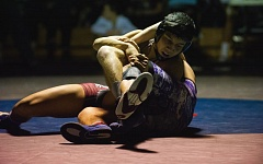 Photo Credit: HILLSBORO TRIBUNE PHOTO: KENT FRASURE - Glencoe's Christian Chan wrestles in the 138-pound final at Saturday's Metro League district tournament, held at Century High School.