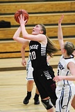 Photo Credit: HILLSBORO TRIBUNE PHOTO: AMANDA MILES - Glencoe sophomore Kaelin Immel drives to the basket for a shot during Tuesday's regular-season finale against city rival Century.