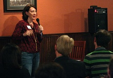 TIMES PHOTO: MILES VANCE - Becky Voorheis of Quickbeam, Inc., tells the audience about her company's product, which aids in the treatment of methamphetamine addiction, at the PubTalk pitch contest at Golden Valley Brewery on Tuesday.