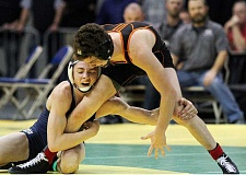 Photo Credit: NEWS-TIMES PHOTO: AMANDA MILES - Banks senior Collin Purinton wrestles against Gladstone's Blake McNall in the 132-pound final at Saturday's Class 4A state tournament.
