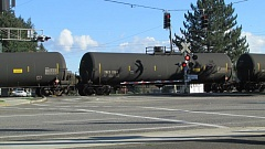 COURTNEY VAUGHN - A unit train carrying crude oil passes through Scappoose on a fall afternoon in 2014. An initiative to try and prevent crude oil and other fossil fuels from being transported in the county is facing legal challenges from opponents.