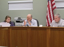 COURTNEY VAUGHN - Scappoose City Councilors Barbara Hayden, Jason Meshell and Mayor Scott Burge discuss matters during a meeting Monday, March 2. The council adopted a revised police contract that evening, but wasn't clear about what it was approving.