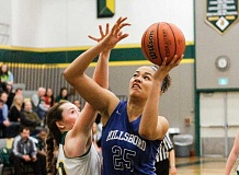 HILLSBORO TRIBUNE PHOTO: CHASE ALLGOOD - Hilhi junior Shariah Green goes up for a shot during last Saturday's NWOC finale against Putnam. The Spartans won the game 52-40 to clinch second place and a bid to the Class 5A state playoffs, which begin on Saturday.
