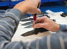 TRIBUNE PHOTO: JOHN M. VINCENT - 203 -- One person assembles each Zero Tolerance knife in Kai USAs Tualatin factory. The new product line is designed around the needs of military, police and other first responders.