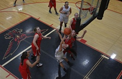 TIMES PHOTO: MATT SINGLEDECKER - Southridge senior Kaley Fieldhouse scoops home a reverse lay-up for two against Lincoln.