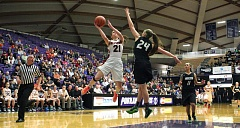 TIMES PHOTO: MILES VANCE - Beaverton's Lexus Miller-Moylan soars for a shot during her team's 43-24 loss to Sheldon the quarterfinals of the Class 6A state tournament at the Chiles Center on Thursday, March 12.