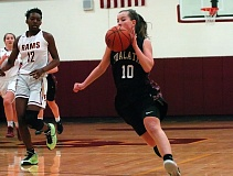 DAN BROOD - Tualatin High School senior Katie Nelson (10) leads a fast break during last week's state playoff game at Central Catholic.
