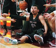DAN BROOD - OUR BALL -- Tualatin senior Alexander Reid claims the ball went out of bounds off a Central Catholic player during Friday's game.