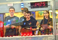 PAMPLIN MEDIA GROUP: VERN UYETAKE - Although only a small group actually drives the robot during matches, it takes a full team to keep Team 1425 competitive. From left, Tristan Briggler, Ryan Kelly, Andrew Kassab and Sami Edwards.