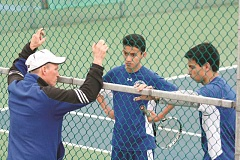 PHIL HAWKINS - Woodburn's former No. 1 doubles teammates Beto Salmeron (middle) and Marco Soria (right) will part ways their senior season. Salmeron moves to the Bulldogs No. 1 singles slot, while Soria will team with David Samano as the team's No. 1 doubles pair.