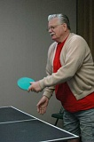 ESTACADA NEWS PHOTO: ISABEL GAUTSCHI - Doug Jamieson gets serious about demonstrating that the Estacada Community Center is a fun place to be, by engaging in a lively ping pong game against Sherril Osborn.