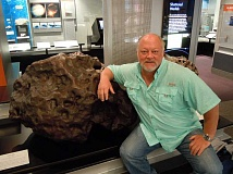 SUBMITTED PHOTO - Edwin Thompson is never happier than when he is around a meteorite, like the one at the Smithsonian Institute. Thompson is now turning his facts into science fiction.