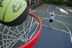 TIMES PHOTO: JAIME VALDEZ - Graham Oelke, 13, a seventh-grader at St. Anthony Catholic School, shoots a free throw at his home in Tigard. Oelke will compete in the Hoop Shoot National Finals in Springfield, Mass. on April 18.