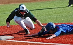 DAN BROOD - Tigard's Jarod Gogal puts a tag on a Churchill player during Monday's jamboree. The Tigers will be host a spring break tournament starting on Saturday.