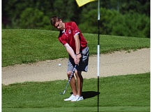 DAN BROOD - SHERWOOD CHIP -- Sherwood senior Joe Reed puts his shot on the green during last year's Class 5A state tournament.