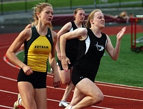 DAN BROOD - SWIFT IN THE SPRINTS -- Sherwood High School senior Emily Johansen (right), shown here at last year's NWOC district meet, leads a strong group of Lady Bowmen sprinters this season.