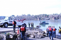 PHOTO COURTESY: CLACKAMAS FIRE  - A pickup is towed out of the Willamette River, where a driver died March 6.