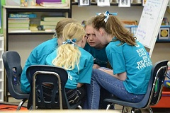 PHOTO COURTESY OF CARLY CARPENTER PHOTOGRAPHY  - Team members Macy Moore, Elia Bartlett, Alexis Gessler and Ella Nielson are intent during their battle at the regional Oregon Battle of the Books - or OBOB - competition held at Boones Ferry Primary School.
