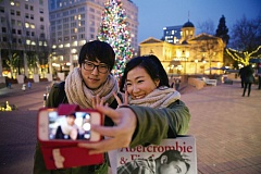 COURTESY: TRAVEL PORTLAND - In the market for a selfie stick? Tourists come to Portland in the winter too, perhaps as a result of Travel Portlands ad campaign. Greater Portland stresses the need for area businesses to try to tap into Asian export markets, and to seek foreign direct investment if the economy is to survive the coming wave of migrants.