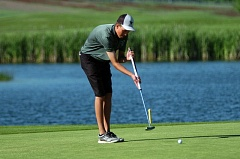 DAN BROOD - ON THE GREEN -- Jon Holzgang, here putting at last year's state tournament, returns for the Tigers this season.