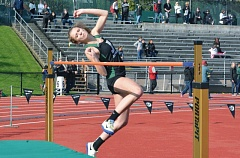TIMES PHOTO: MATT SINGLEDECKER - Jesuit's Claire Corbitt won three events for the Crusader girls track team on April 1 including the high jump to help Jesuit beat Sunset at home.