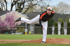 JOHN WILLIAM HOWARD - Scappoose senior Owen Fortney throws out a pitch late in the game on Tuesday afternoon against Banks. Fortney struck out nine batters and hit the go-ahead home run in the bottom of the sixth inning.