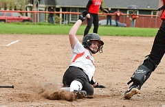 JOHN WILLIAM HOWARD - Scappoose's Allison Wedgeworth slides into home in the bottom of the third inning to put the Indians on top of Corbett 7-0. The Cardinals came into the game ranked sixth in the state with an 11-1 record.