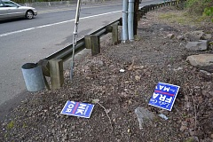 SUBMITTED PHOTO - Thomas Frank said he has lost nearly 100 yard signs since the campaign began, including this sign which was cut in half.