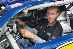 TRIBUNE PHOTO: JOHN M. VINCENT - Portlands Gary Bockman - shown here in a Great American Stock Car race car - has been a driver, instructor, race official and organizer. Hes won two road course championships in the Great American Stockcar Series.