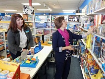 GAZETTE PHOTO: BARBARA SHERMAN  - MudPuddles owner Kate Noreen (left) showed many fun educational toys and games to Congresswoman Suzanne Bonamici and demonstrated how they worked, and then Bonamici got busy shopping for her niece's two small children.