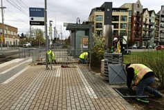 COURTESY TRIMET - Crews work at the Civic Dr MAX Station, laying the conduit for e-fare card readers that will be installed in the future.