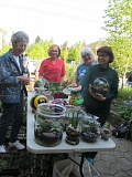 PHOTO BY ELLEN SPITALERI - From left, Audry Trubshaw, Kim Olson, Pat Hodgin and Sandy Moat check out the yard art and terrariums to be sold at this weekend's Ledding Library Plant Sale.