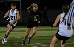 RAFAEL GONZALEZ - Oregon City junior midfielder Lindsi Peters heads for the goal after dodging the defense of Clackamas Bailey Faust. Peters had a big night in the 19-5 rout of the Cavaliers, scoring eight goals and assisting on four more.