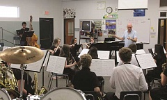 LINDSAY KEEFER - North Marion High School's concert band, led by director David Church, practices for the state competition, held Wednesday at Oregon State University.