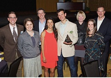 COURTESY TECHNOLOGY ASSOCIATION OF OREGON - Sam Blackman stands with his wife Adriane Blackman (orange dress) and others from the Elemental team. Blackman, CEO and founder of Elemental Technologies was awarded 2015 Technology Executive of the Year by the Technology Association of Oregon.