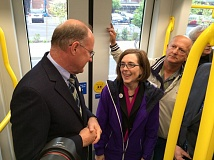 TRIBUNE PHOTO: JOHN VINCENT - TriMet General Manager Neil McFarlane talks with Gov. Kate Brown Friday morning during the first trip of the new Orange Line train into Milwaukie.