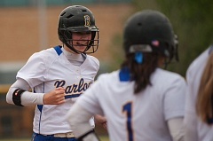 Barlow's Katie Powers is greeted at the plate following a towering fifth inning homer.
