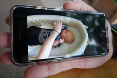 JOSEPH GALLIVAN - A cell phone video showing Mandi Middlestetter placing a Lullafi prototype into the crib of her baby Luca to help him go to sleep.