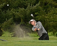 VERN UYETAKE - Chloe Barnes blasts a shot out a trap at the district golf tournament this week. She shot a 76 on the second day to help her team to a victory.