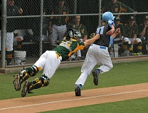 VERN UYETAKE - West Linn catcher Cole Kinman makes a diving tag to record an out during Tuesday's home game against Lakeridge.