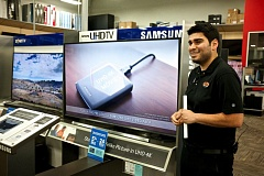 TRIBUNE PHOTO: JAIME VALDEZ - Best Buy Geek Squad store manager Aryan Rahpeik shows off a Samsung ultra high definition (4K) television  that has proved popular in the Cedar Hills store.