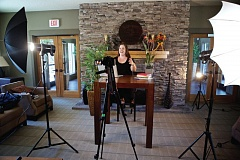 TIMES PHOTO: JAIME VALDEZ - Shannon Kaiser uses an common area at her condominium to record a video for her YouTube channel Play With the World.