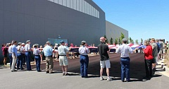 HOLLY M. GILL - Madras JROTC, veterans and others help unfurl a 30-by-60-foot flag on Flag Day, June 14, at Erickson Aircraft Collection. The enormous flag is the largest flying in the state.