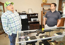 GARY ALLEN - Rick (left) and Nick Swecker are the proprietors of a new firearms business in Newberg, called One Shot Gun Shop.