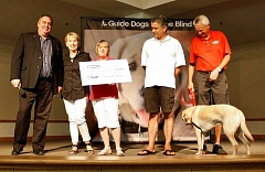 PAMPLIN MEDIA GROUP: KYLIE WRAY - Nancy Jaksich, second from left, and other Suburban Auto Group personnel, present Guide Dogs for the Blind with a $30,050 donation at its graduation ceremony on Saturday, June 6.