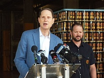 TRIBUNE PHOTO: JENNIFER ANDERSON - Sen. Ron Wyden (D-Ore.) recently announced a bill that would lower excise taxes for Oregons burgeoning brewing, distilling, and winemaking businesses. Behind Wyden is Christian Ettinger, brewmaster at Hopworks.