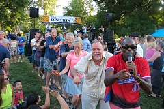 PHOTO COURTESY OF PORTLAND PARKS AND RECREATION - Adults form a dancing line during a Portland Parks and Recreation Concerts in the Park event.