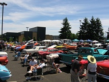 COURTESY OF TAMMY BELWOOD - People chat and take a look at classic cars at the Highway 30 Cruise-In on Saturday, June 20, out in front of Scappoose High School.