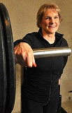 STAFF PHOTOS: VERN UYETAKE - Linda Graybeal smiles at the idea of being a world record-setting powerlifter. She has always been a great athlete, but she never expected to end up in a muscle magazine.